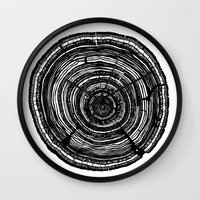 tree rings Wall Clocks featuring Tree Rings by Irene Leon