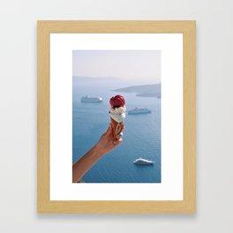 Hand holding melting ice cream in Santorini Framed Art Print