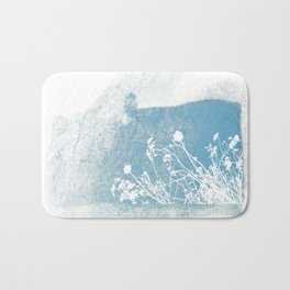 Shadow of wild flowers on a blue watercolor wall Bath Mat