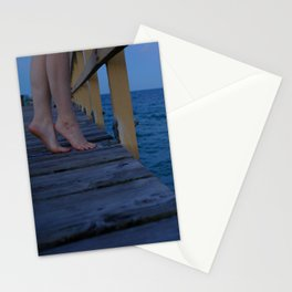 Woman standing on the edge of a pier Stationery Cards
