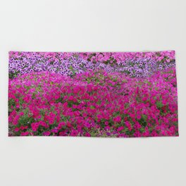 Waves of color on a sea of Petunias Beach Towel