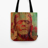 frankenstein Tote Bags featuring frankenstein by Ganech joe