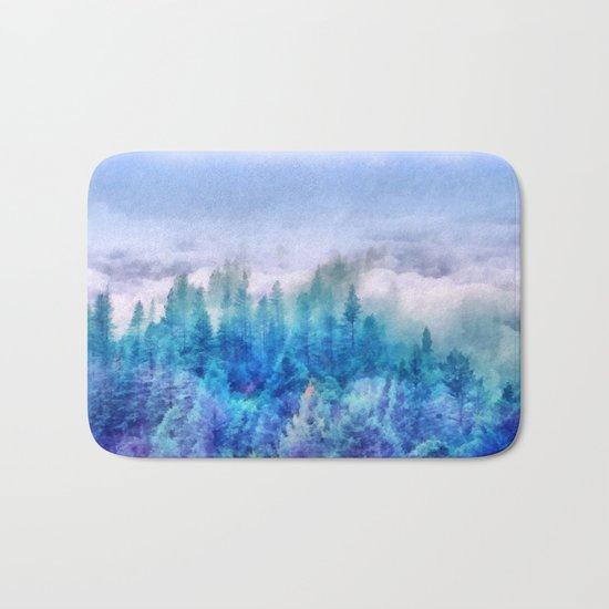 Clouds over pine forest Bath Mat
