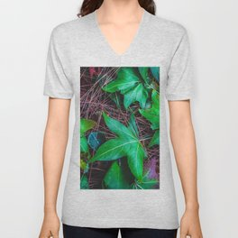 closeup green leaves on the dry grass Unisex V-Neck