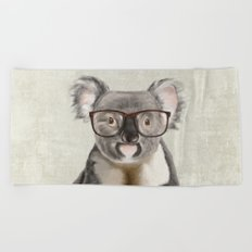 A baby koala with glasses on a rustic background Beach Towel