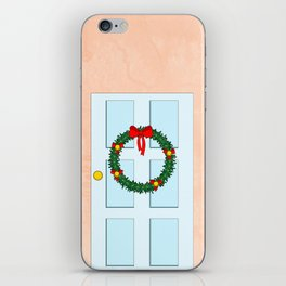 Traditional Christmas wreath on an old fashioned door iPhone Skin