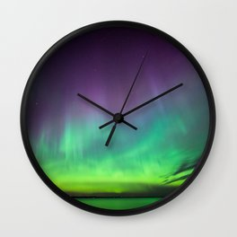 Northern lights over lake in Finland Wall Clock