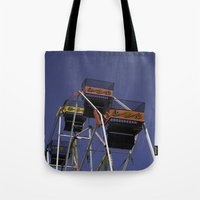 ferris wheel Tote Bags featuring Ferris Wheel by Steve Purnell