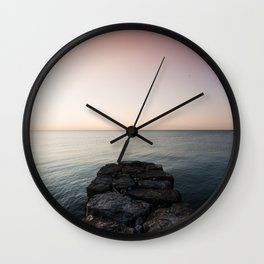 Sunrise Over the Rocks Wall Clock