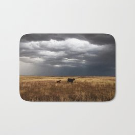 Life on the Plains - Cow Watches Over Playful Calf in Oklahoma Bath Mat