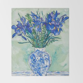 Iris Bouquet in Chinoiserie Vase on Blue and White Striped Tablecloth on Painterly Mint Green Throw Blanket