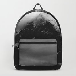 White clouds over the dark mountains Backpack