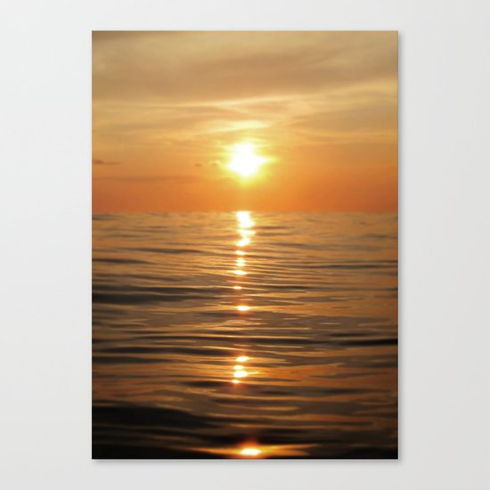 Sun setting over calm waters Canvas Print