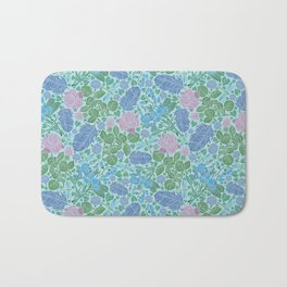 Blue feathers with pink roses and dragonflie on blue background Bath Mat