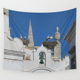 storks build nests on the church in the old town of faro, portugal, europe Wall Tapestry