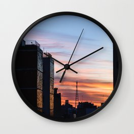 Beautiful sunrise in the city. Sunlight break down throughout the buildings and shine bright. Wall Clock