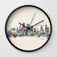 kansas city Wall Clocks featuring kansas city Missouri skyline by bri.buckley