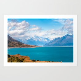 Blue waters of Lake Pukaki with snow-capped Mount Cook in the background in New Zealand Art Print