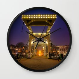 Skinny bridge at the Amstel river in Amsterdam by night. Wall Clock