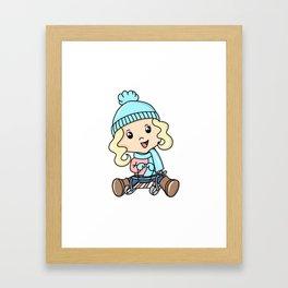 Girl Sledding On The Snow Framed Art Print