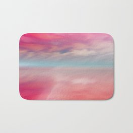 """Rose quartz sky on beach shore"" Bath Mat"