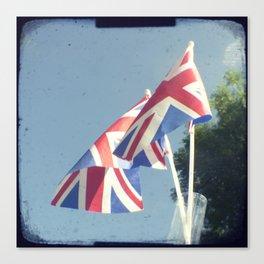 Flags - Union Jacks against a blue sky Canvas Print