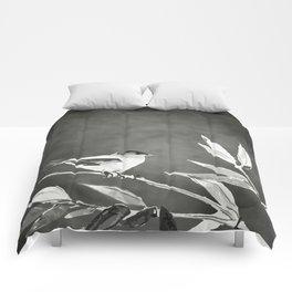 Little bird on bamboo branch. Comforters
