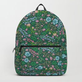 Violet clover and lupine among cornflowers and herbs Backpack