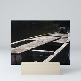 dark boat at twilight Mini Art Print