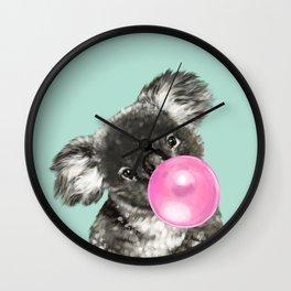 Playful Koala Bear with Bubble Gum in Green Wall Clock