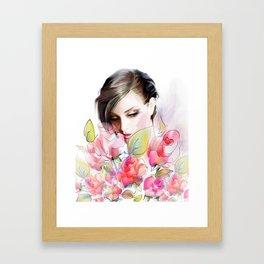 Girl and roses Framed Art Print