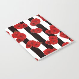 Red poppies on a black and white striped background. Notebook