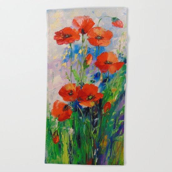 Poppies in a field Beach Towel
