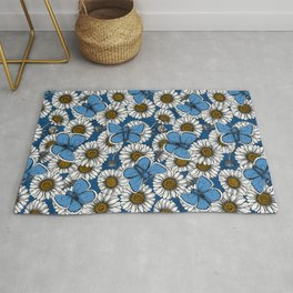 Daisies and butterflies on a classic blue background Rug