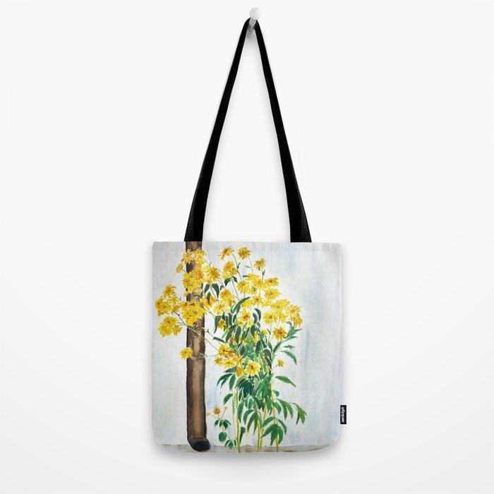 sun choke flowers outside a house Tote Bag