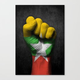 Myanmar Flag on a Raised Clenched Fist Canvas Print