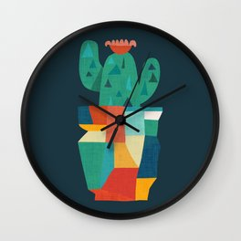 Blooming cactus in cracked pot Wall Clock