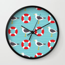 Segulls and life ring on wavy blue Wall Clock