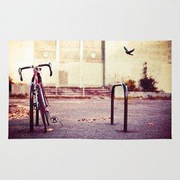 Abandoned bike Rug