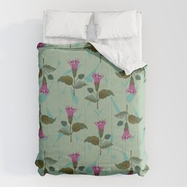 Datura flowers on a light blue grassy background Comforters