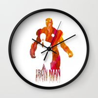 iron man Wall Clocks featuring Iron Man by Jon Hernandez