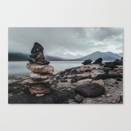 Cairn stack of rocks at Laguna Blanca on a stormy day in Bolivia Canvas Print