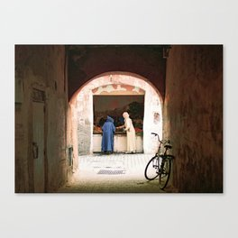 Two women at a market in the souks, Medina in Marrakech Morocco Canvas Print