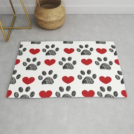 Doodle black paw print with red shining hearts seamless pattern Rug