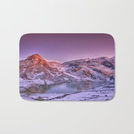 Panoramic view of Lake Ercina with snow in Asturias, Spain. Bath Mat