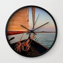 Sailing Towards Lighthouse at Sunset Wall Clock