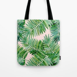 Green palm leaves on a light pink background. Tote Bag