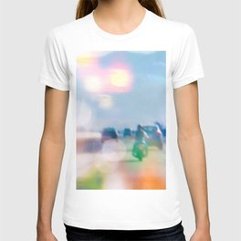 car and motorcycle on the road in the city with bokeh light T-shirt