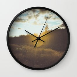 sunset slanted in a field Wall Clock