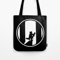 rocket raccoon Tote Bags featuring Rocket Raccoon by Comix